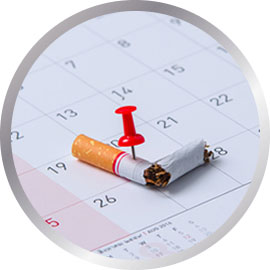 Cigarette snapped with pin on calendar date