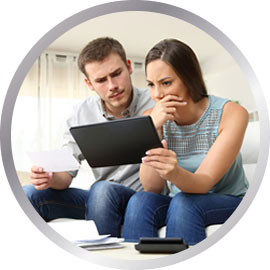 Couple looking at life mortgage policy on tablet